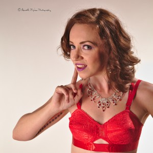 a woman wearing a red bra showing sexiness and lingerie